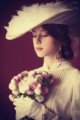 Картина Красивая рыжая женщины с букетом
