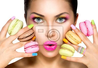 Картина Beauty fashion model girl taking colorful macaroons