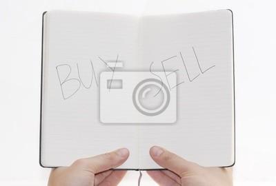 Купить / продать выбор в блокноте, на белом фоне.