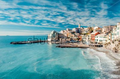 Картина View of Bogliasco. Bogliasco is a ancient fishing village in Italy, Genoa, Liguria. Mediterranean Sea, sandy beach and architecture of Bogliasco town. Cloudy blue sky sunny day idyllic scenery, winter