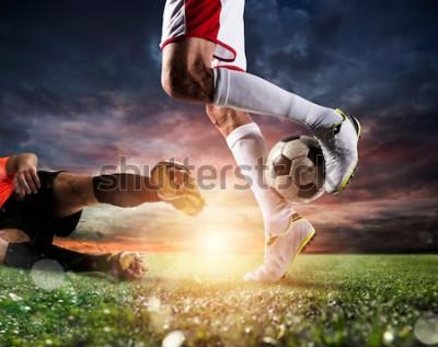 Картина Футболисты с футбольным мячом на стадионе во время матча