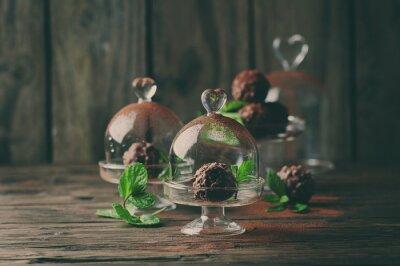 Картина Шоколадные конфеты с орехами, мяты и какао на винтажном столе