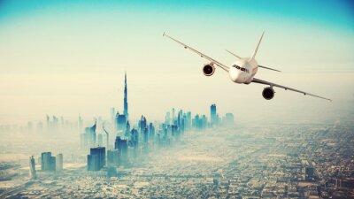 Картина Коммерческий самолет пролетел над современным городом