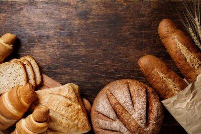 Картина Различные хлеб на деревенском темном фоне