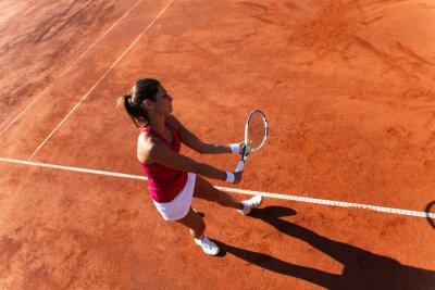 Картина Female tennis player serving a tennis ball