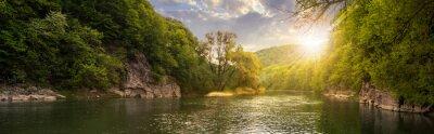 Картина лес река с камнями на берегу на закате