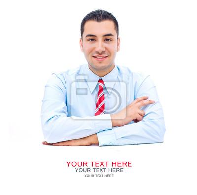 Красивый молодой человек за столом пространство для вашего текста