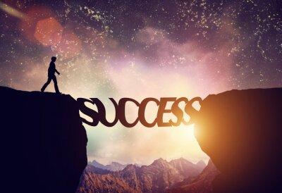 Картина Man about to walk over precipice on SUCCESS word bridge