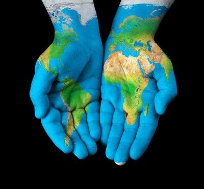 Картина Карта написаны на руки, показывая концепции - мир в наших руках