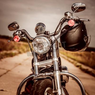 Картина Мотоцикл на дороге с шлемом на руле.