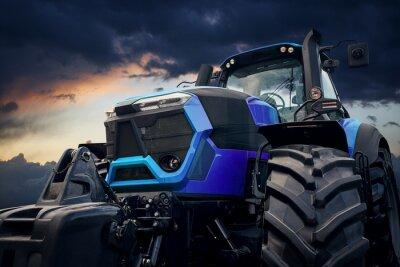 Картина Мощный трактор против бурного неба