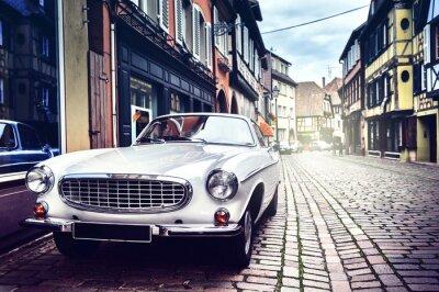 Картина Retro car in old city street
