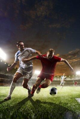 Картина Футболисты в действии на закат стадиона фоне