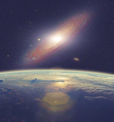 Картина Sunrise over Earth with great Andromeda galaxy.
