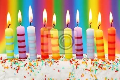 Десять день рождения свечи на розовом фоне