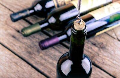 Картина Винные бутылки на деревянном столе