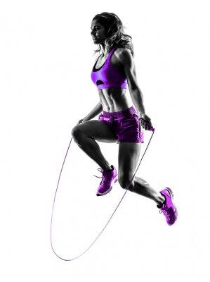 Картина женщина фитнес упражнения прыжки со скакалкой силуэт