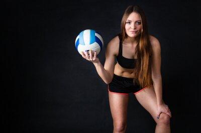Картина Молодая девушка держит в волейбол на черном фоне