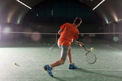 Картина Молодой теннисист ногами бал