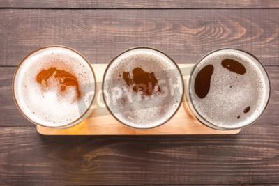 Фотообои Ассортимент пива очки на деревянном фоне. Вид сверху.