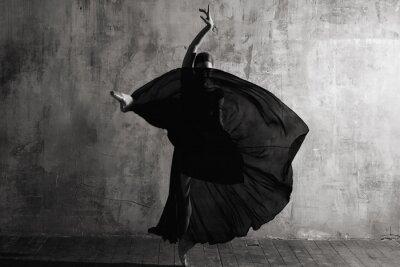 Фотообои Ballerina in ballroom. Ballet dancer in studio. Black and white monochrome.