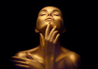 Фотообои Beauty sexy woman with golden skin. Fashion art portrait closeup. Model girl with shiny golden professional makeup. Gold jewellery