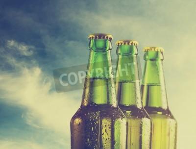 Фотообои Пивные бутылки на пляже. Ретро-фильтр.