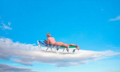 Фотообои Blur of a blondie woman sunbathing on the clouds
