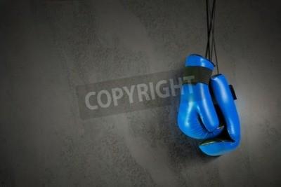 Фотообои Боксерские перчатки, висящие на гвоздь на стене