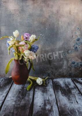 Фотообои Ceramic jug with spring flowers on wooden table