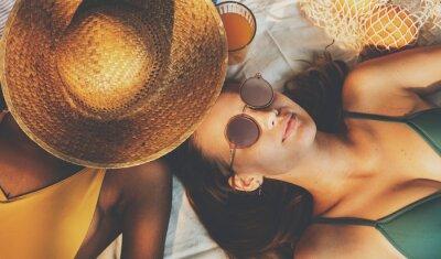 Фотообои Cheerful girls in swimsuit sun tanning together