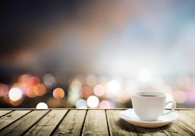 Фотообои кофе на столе в ночном городе