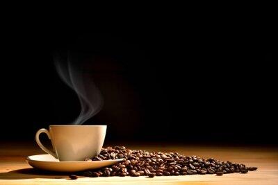 Фотообои Чашка кофе с дымом и кофейных зерен на фоне старых деревянных
