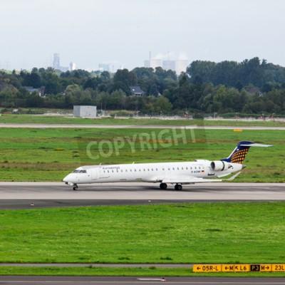 Фотообои DUSSELDORF, GERMANY - SEPTEMBER 05, 2015: Eurowings Bombardier CRJ-900 NG arrives to the Dusseldorf International Airport.