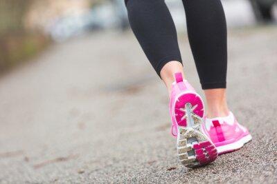 Фотообои Female Runner Shoes closeup on the road, town setting.