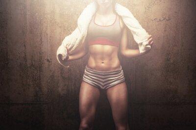 Фотообои Fitness woman after hard workout training holding white sports towel