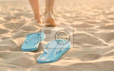 Фотообои Flip-flops on sand beach at resort