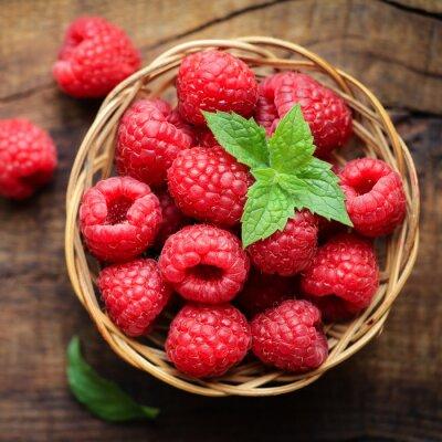 Фотообои Fresh ripe red raspberries in a wicjer bowl on dark rustic wooden background