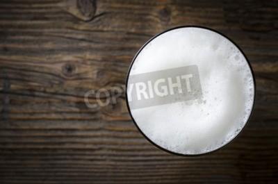 Фотообои Стакан пива пены на деревянный стол