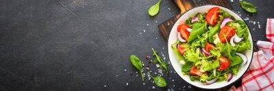 Фотообои Green salad from leaves and tomatoes.