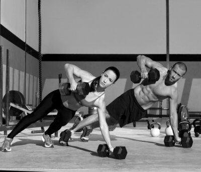 Фотообои Тренажерный зал мужчина и женщина сила пуш-ап отжимания