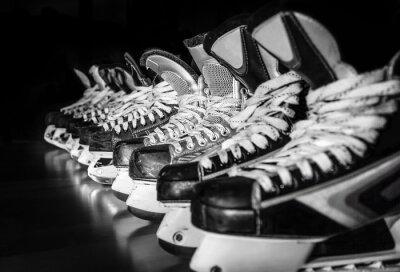 Фотообои Hockey skates lined up in locker room