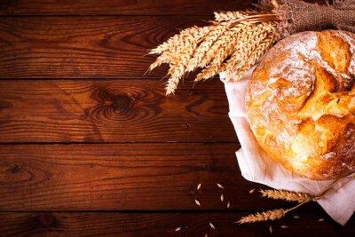 Фотообои Домашний хлеб на деревянном фоне. Страна стиль. Пищевая выпечка фон