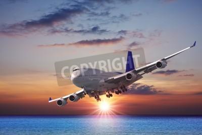 Фотообои Jet лайнер над морем на закате