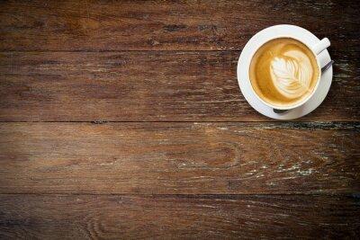 Фотообои кофе латте по дереву с пространством.