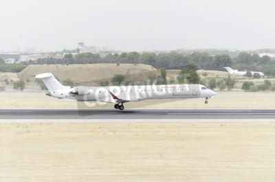 Фотообои Мадрид, Испания - 8 августа 2015: Самолеты -Bombardier Канадэйр CRJ-900-, из -Air Nostrum- авиакомпании, посадки в аэропорту Барахас -Adolfo Suarez-, 8 августа 2015.