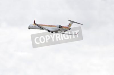 Фотообои Мадрид, Испания - 14 июня 2015: Самолет -Bombardier Canadair CRJ-1000-, авиакомпании -Air Nostrum-, взлетает из аэропорта Мадрид-Барахас -Adolfo Suarez-, 14 июня 2015 года.
