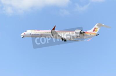 Фотообои Мадрид, Испания - 14 июня 2015: Самолет -Bombardier Canadair CRJ-900-, авиакомпании -Air Nostrum-, взлетает из аэропорта Мадрид-Барахас -Adolfo Suarez-, 14 июня 2015 года.