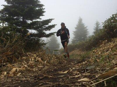 Фотообои Man running on high mountain trail