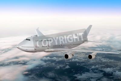 Фотообои Современный самолет над облаками.